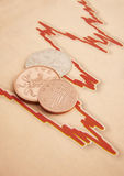 Coins on graph paper Stock Photo