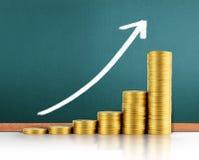Coins graph stock market Stock Photos