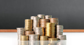 Coins graph stock market Royalty Free Stock Photography