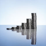Coins Graph. On surface with reflection Royalty Free Stock Photo