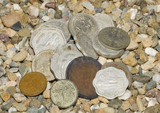 Coins on gravels. Heap of ol coins on gravels Royalty Free Stock Photography