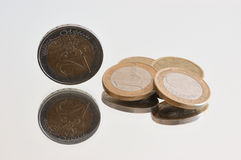 Coins. Group of coins with their reflections on the table Royalty Free Stock Photography