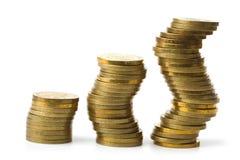 coins guld- isolerade buntar tre Royaltyfri Bild