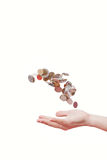Coins in the hand Stock Images