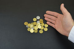Coins in hand. Bronze coins in man`s hand Royalty Free Stock Image