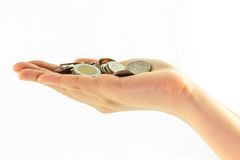 Coins on hand isolate Stock Photo