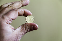Coins in a hand Royalty Free Stock Photography