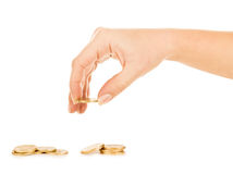 Coins and hand Royalty Free Stock Image