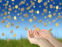Coins and hands Stock Images