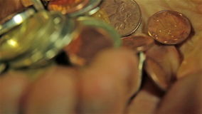 Coins in Hands. Close up shot stock footage