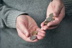 Coins in hands closeup Royalty Free Stock Photography