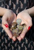 Coins in the hands of a girl. Money in the hands of a girl Stock Image