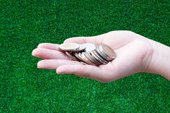 Coins in hands on grass. Donation Investment Fund Financial Support Charity  Dividend Market Growth Home House Stock Trust Wealthy Giving Planned Accounting Royalty Free Stock Image