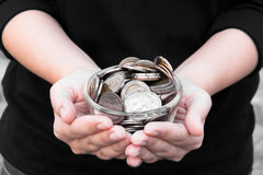 Coins in hands saving,Donation Investment Fund Financial Support Charity  Dividend Market  House Stock Photo