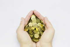 Coins and hands Royalty Free Stock Photos