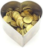 Coins in a heart shape stainless steel pastry cutt Stock Photo