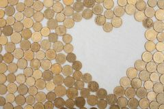 Coins with heartshaped textfield Royalty Free Stock Photo