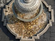 Coins in historic fountain Stock Image