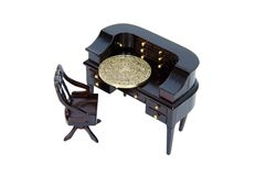 Coins Home Investment. Homey dark wood chair and desk with many drawers and working areas with an intricate coin for investments - Path included Stock Images