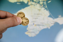 Coins in honor of the Crimea to Russian Federation stock image