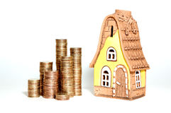 The coins and house. Real estate moneythe coins and house Royalty Free Stock Images