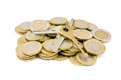 coins and house keys Royalty Free Stock Image