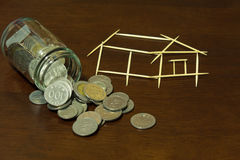 Coins and house from Toothpick. Coins and picture house from Toothpick Stock Photo