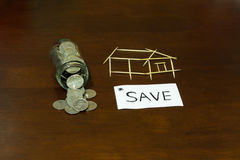 Coins and house from Toothpick. Coins and picture house from Toothpick Royalty Free Stock Image