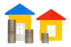 Coins and Houses. Isolated coins and houses on white background Stock Image