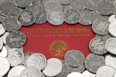 Coins and housing accumulation fund bankbook Royalty Free Stock Images