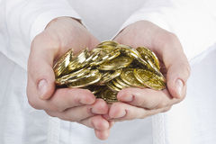 Coins In Hands Stock Photos