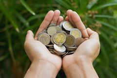 Free Coins In Human Hands, Save Money For The Future Business, Investment And Finance Concept Stock Images - 138066994