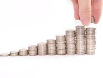 Coins increase Stock Photos