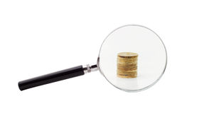 Coins increased magnifying glass Royalty Free Stock Photography
