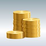 Coins isolated. Gold coins on a white background Royalty Free Stock Photo