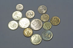 Coins isolated on the grey background Royalty Free Stock Photography