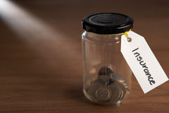 Coins in a jam jar Royalty Free Stock Image