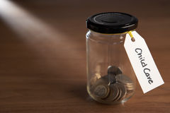 Coins in a jam jar royalty free stock images
