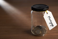 Coins in a jam jar Stock Image