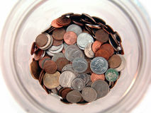 Coins in jar Royalty Free Stock Photos