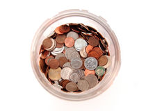 Coins in jar Stock Photography