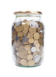 Coins in the jar Stock Images