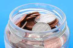 Coins in a jar Stock Image