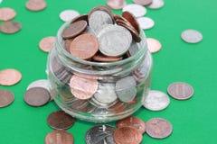 Coins in a jar Stock Photos