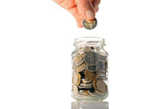 Coins in a jar Royalty Free Stock Image