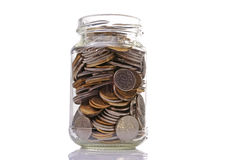 Coins in a jar stock images