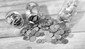 Coins in a jar on the floor. Accumulated coins on the floor. Sav Stock Photo