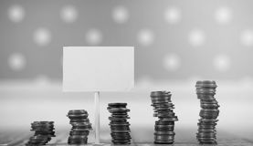 Coins in a jar on the floor. Accumulated coins on the floor. Sav Stock Images