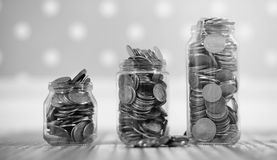 Coins in a jar on the floor. Accumulated coins on the floor. Sav Royalty Free Stock Photography