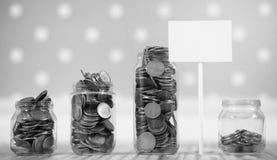 Coins in a jar on the floor. Accumulated coins on the floor. Sav Royalty Free Stock Photos